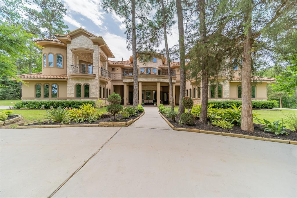 This gated community offers tranquility, acreage homesites and mature trees throughout.  Driving through the low water crossing, viewing deer and other wildlife add to the picturesque scenery Teaswood offiers.  Just minutes to I-45 and conveniently located near shopping, dining and entertainment.  Circle drive with gated entrances and separate 2 car garages.  Relax on your choice of spacious balconies while enjoying your morning coffee or evening beverage.