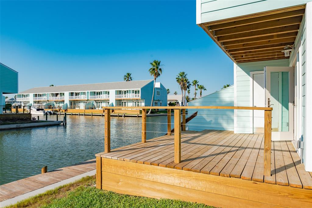 New from the studs out, this freshly and beautifully refinished waterfront condo in desirable Key Allegro is the perfect place to get back to living! Enjoy sublime views of two canals from both the living room & master bedroom & decks, with a dock below for your boat. Downstairs are half bath, living/dining, laundry with washer/dryer included, & wonderful kitchen with quartz countertops, brand new, all-electric stainless appliances. Luxury vinyl plank flooring throughout. Upstairs are master with deck overlooking two canals, beautiful master bath with barn doors, spacious guest bath & guest bedroom. Both bedrooms have vaulted ceilings for a spacious feel, ceiling fans throughout. Two assigned parking spaces per unit.