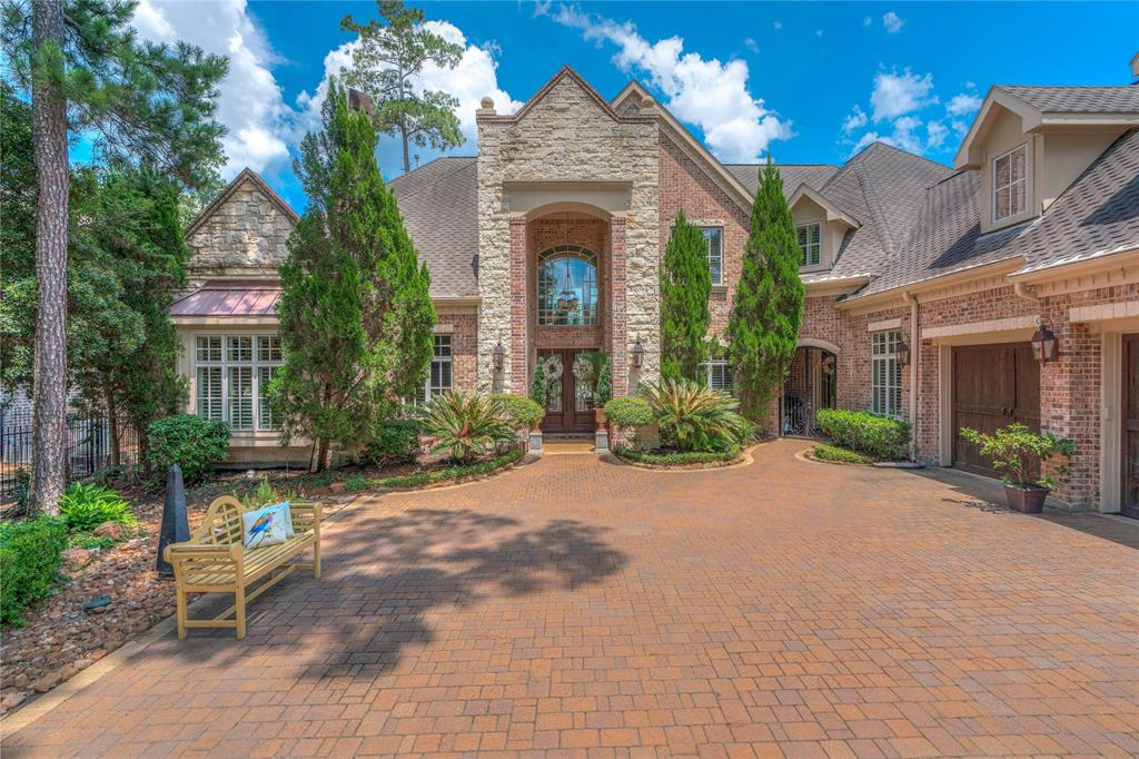 Amazing former showcase home from builder Tom Cox, this home sits on the 12th fairway of the exclusive Woodlands CC Player Course. One of the most stunning homes in Sterling Ridge, this Country French home features a gated entry and paved extra-wide driveway. As you enter the property it evokes images of the old woprld with its grand entry and Foyer.  Triple-finished garage, majestic cathedral ceilings upon entry and vistas of the well though out backyard and pool areas welcome you to your home. The owner's suite features a sumptuously appointed bath and impressive closet. Three more bedrooms with en-suite upstairs and a full wing of the house dedicated to guests with a 5th bedroom, full bath and lounge area awaits.