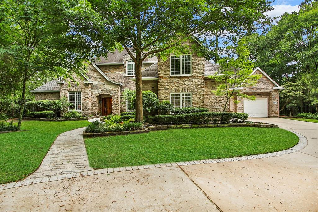 Gorgeous, impeccable  Tom Cox Sr. custom home on huge estate lot with waterfront on Pastoral Pond in Grogans Point. Never flooded, high and dry! Home features fireplace in Master bedroom and duel fireplace in library/family room. Enjoy the outdoors with beautiful views to Pastoral Pond out back, plus a screened-in porch with summer kitchen. Perfect for entertaining. Fourth bedroom and media room could be converted into 2nd master suite upstairs with its own staircase/entrance from garage. This home features an elegant, wood-paneled office and a separate library that could also serve as an office - perfect for the busy professional . This energy efficient home features Kolbe insulated windows, zoned climate control, high-SEER air conditioning and extra insulation. Zoned to high-performing schools, close to hiking/biking trail system of The Woodlands, and only 12 minutes from I-45.