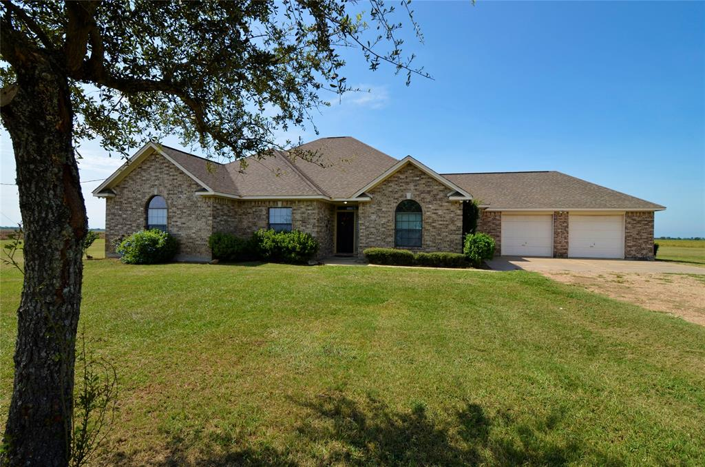 Country property w/ 5 acres, and zoned to highly rated Needville ISD schools. 4 BR, 2.5 BA home w/3112 sq ft, w/all BR downstairs w/ walk-in closets. High ceilings and crown molding add to the architectural appeal of the home. Upstairs is a very spacious game room with double closet and storage areas.  Area has entrance to attic for additional storage space.  Appealing architectural features w/ extended crown molding. 2 car attached garage and an electronic gate for property entrance. Home is pre-wired for a security system. Home has 2 AC units w/ zoned system. Enjoy your open, gourmet style kitchen w/ granite counters, breakfast bar, island w/ storage, gas cook-top, walk-in pantry, and double ovens. Master suite has abundant space, lighted ceiling fan, and a door leading to outside porch area.  Garage has stairs which lead to attic. Sit on your covered back patio and look out to your pond area, and enjoy country living at its finest!  Come on HOME......the welcome mat is out for you!