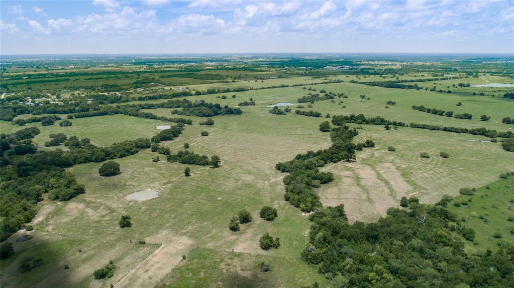 250 acres available out of 684.7 acres of a Working Cattle ranch. Choose your favorite side. Can be mostly open pastures with rolling terrain and a beautiful valley, or enter through a heavily wooded area, cross Sand Creek before  finding your way to the hilltop building site which overlooks rolling cattle pastures dotted with scattered ponds and oaks.Located at the edge of Navasota, only 30 minutes from Texas A&M, within an hour of Houston, this is a wonderful opportunity to invest in the fast growing Tex-A-Plex!!! Central Texas is the place to be if you are looking for a safe long term investment. Enjoy clean fresh air, the serenity of starry skies at night, beautiful sunsets in the evenings and just plain old fashioned country living. The deer and other wildlife offer the sportsman recreation opportunities. Build your new home on the hilltop and or a new lake along Sand creek. Pictures show entire 684.7 acres being offered for sale.