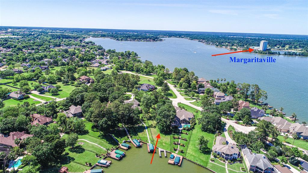 FEEL LIKE YOU ARE ON VACATION EVERY DAY at this wonderful homesite for your dream home! Come make it yours and build to your preferences and liking. This waterfront lot is rare for it's size. You have almost 1 acre on Lake Conroe! So you can break the mold of tiny, cramped, sardine like waterfront lots and get some elbow room to enjoy on the water. The views are beautiful and this lot offers the protection of a cove with the views and location akin to open water. This lot also already has a boat slip and dock that are recent improvements. There are also plenty of shade trees so you can plan your home to have a nicely landscaped area with mature trees from the start. This beautiful waterfront lot is in The Cliffs at South Shore which is a wonderful gated community close to everything for easy access to everyday needs. Montgomery schools is yet another positive about this lot, and there are more....like no severe slopes where home would go, gorgeous setting, great location...come get it