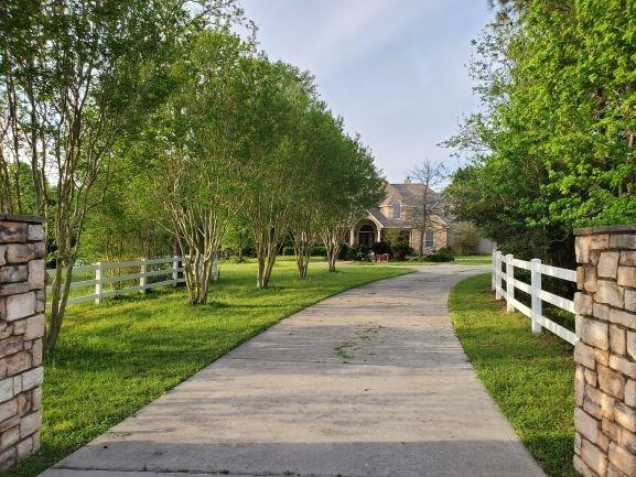 Magnificent well maintained home on a 8+ sprawling acre estate (NOT a flood zone)established within an equestrian friendly neighborhood,sparkling POOL & expansive covered patio w/outdoor kitchen;property features CROSS fencing,2 circular drives & 2 entry points.This luxurious home provides 5 bedrooms/4.5 baths/3 vehicle garage,a BARN(Barndominium)w/9 horse stalls(TACK/OFFICE Rm. with LOCK DOOR ACCESS)w/over-barn-2 bedroom suite w/2 full baths,full function kitchen & laundry fantastic for addl. family/guests.The main home is very family functional with Master Bdrm & 2nd bedroom both on 1st floor,2 staircases for easy upstairs access,BOTH formals,dual studies,media/GM room&2nd Mster Bedroom upstairs.UPGRADES incld. elevated & vaulted ceilings,modern open floor concepts,EXTRA large island kitchen w/breakfast,butler's pantry& MANY MORE.NEW updates: hardwoods & tile flooring,NEW interior paint,19'HVAC replacements,new CML.water heaters,surround sound,LED lighting.Grocery & Shopping CLOSE BY