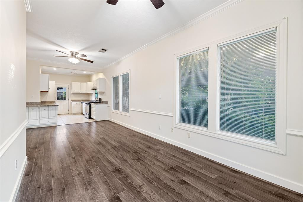 Living room is open to the kitchen and dining area. Updates include laminate flooring.