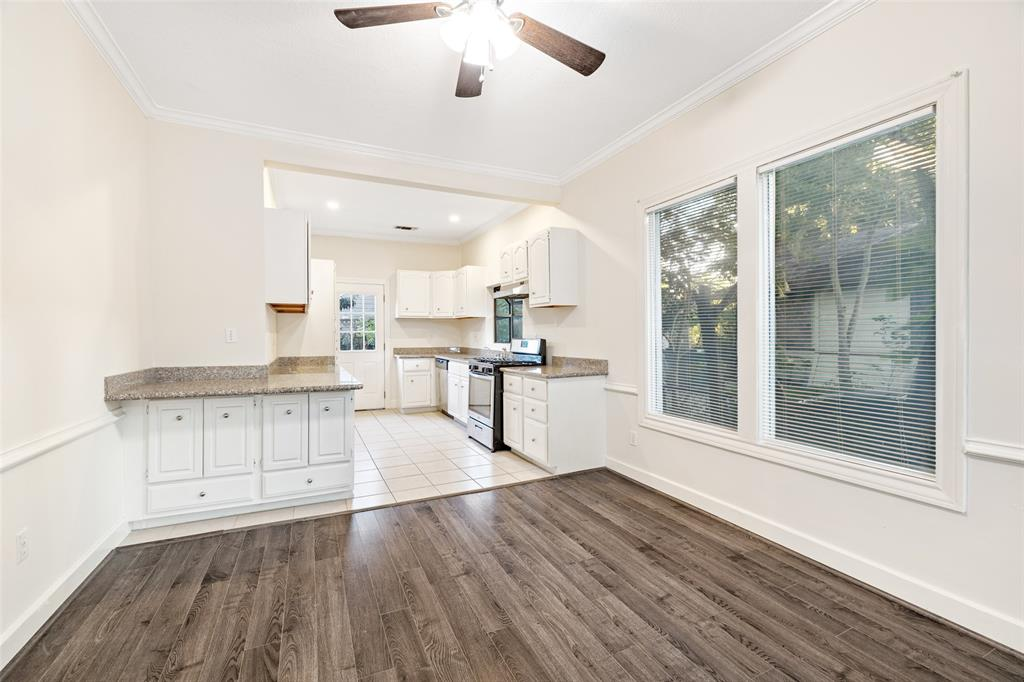 Dining area is open to kitchen. Kitchen includes breakfast bar.
