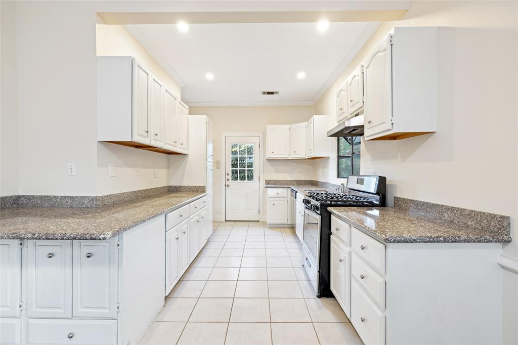 Kitchen includes tons of storage and prep space. Also includes a 4 burner gas range.