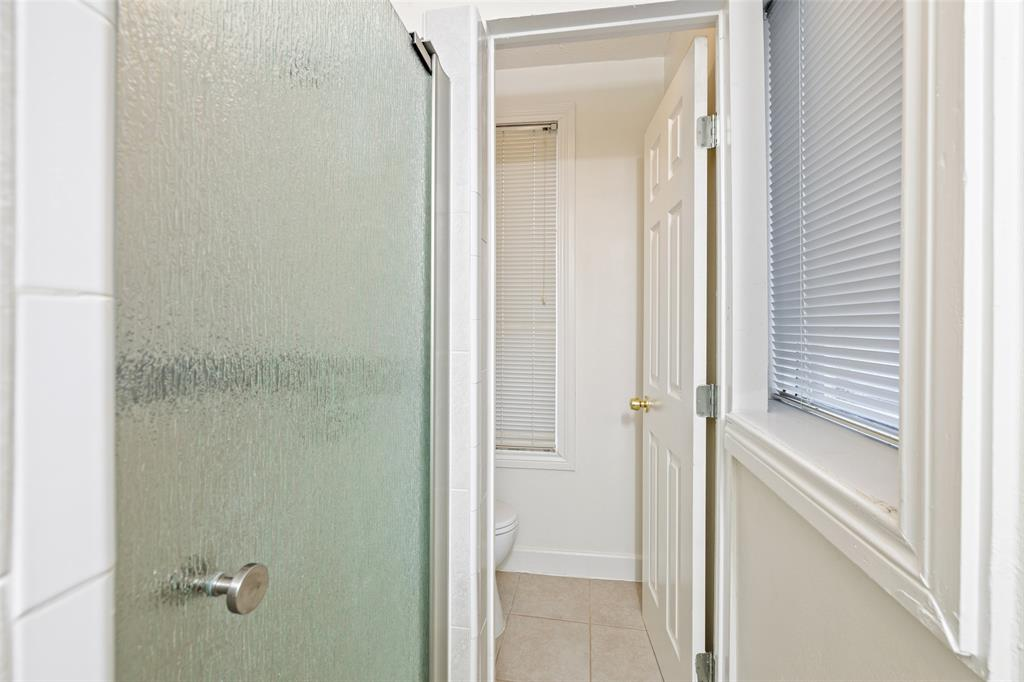 This is an en suite and includes a stand-up shower and vanity.