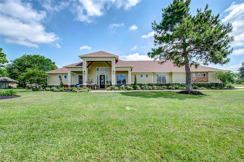 Stunning custom one story! 3 bedrooms, 3 baths, and 3 car garage. Built in 2016, this 3290 sq ft Pattison home is situated on a beautifully landscaped 1.23 acre lot. The home has gorgeous rustic-sheek finishes w/one-of-a-kind touches. Study with double-sided saltwater aquarium with views from the den. Open concept floorpan that's perfect for entertaining. Incredible master suite w/double-sided fireplace, master bathroom ready for a home spa day everyday! Custom screened in patio with outdoor kitchen and fireplace creates a perfect place for a movie night and those can't miss football games! There's plenty of room for a pool and to make the backyard your own private oasis! Supreme luxury in a country setting! Exterior of the home has James Hardie Stucco and Stone. Fog mosquito system, Gutters. ADA accessible throughout. Pex plumbing w/manifold control. 8 ft doors, 10 ft ceilings, Tri-zoned a/c system, waterproof eng flooring. Custom plantation shutters and roller screens on pic windows.