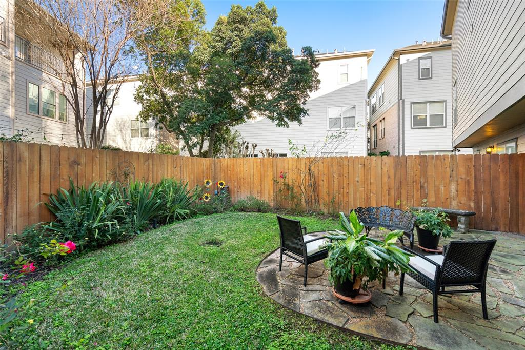 The large, fully fenced back yard is a rare find in the Inner Loop.