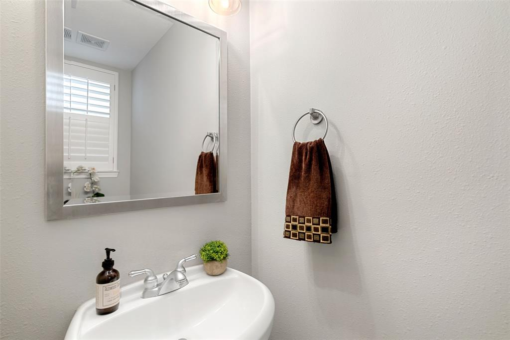 The half bath on the second floor is perfect for guests.