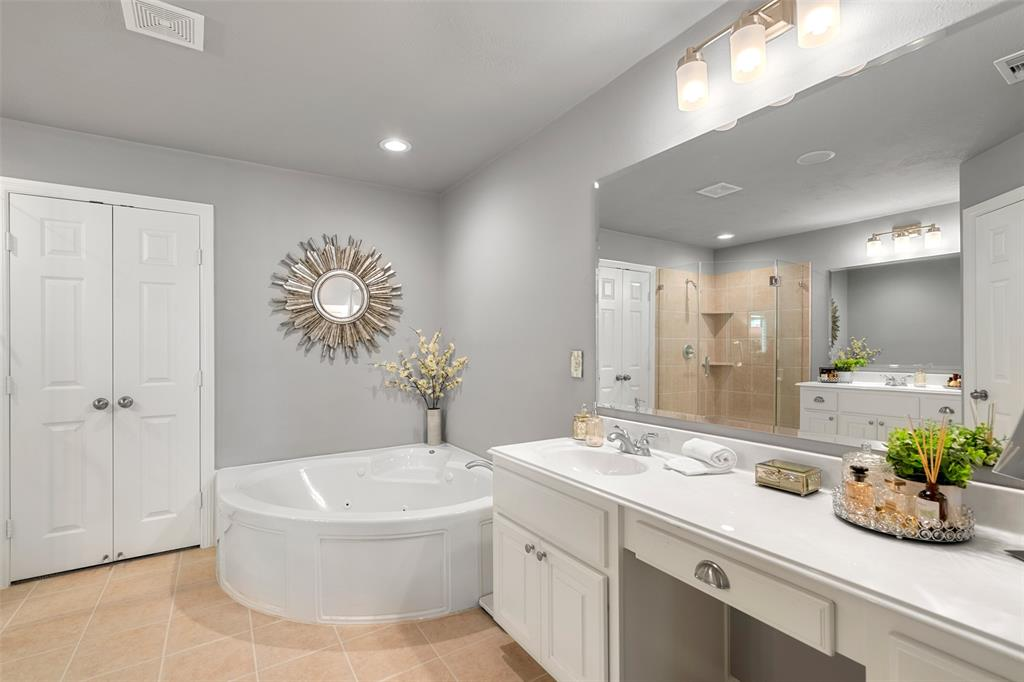The master bath features dual vanities, jetted tub and professionally cleaned and sealed floor tile.