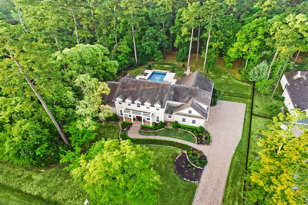 "Imagine working from home in this gorgeous retreat! This Robin Rueby masterpiece is a timelessly designed, elegant home with exquisite architectural elements. Home boasts of reclaimed hardwood floors, chefs kitchen, exquisite millwork, coffered ceilings and 2 stairways.Breathtaking backyard retreat is complete with built-in barbecue, brick fireplace, and stunning infinity saltwater pool/spa. An entertainers dream! Inside you'll find a Chefs kitchen with oversized island, breakfast area and generously sized living area. Across the hall is a handsomely designed office. The master bedroom overlooks the pool and private wooded 1.7 acre lot. Master bath has large walk-in shower, and ""his and hers"" closets! Also on the first floor is a private flex room with full bath that could be a fitness room, in-law or nanny suite, or children's play area. Upstairs is a large game/media room w/desk.Down the hall you'll find 4 large BR's with private baths. Truly an exceptional home!"