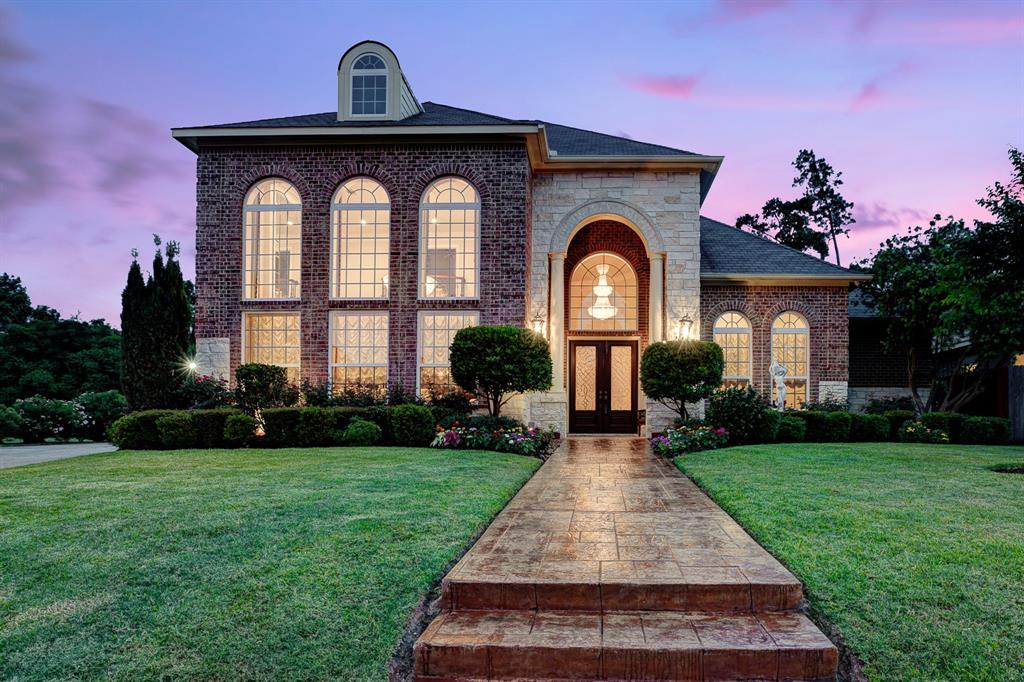 This custom designed Goshy Home in the idyllic community of Wimbledon Champions Estates is what you've been dreaming of. Upon passing through the majestic columns of the stone façade, you will be greeted by tile flooring and the curved wrought iron staircase of the grand entry. Gather your family and friends in the impressive great room with a fireplace, floor to ceiling windows, and wood flooring and the open family room with a dry bar. Other distinguishing features include a dining room, study, a game room, and lavish features throughout. Featuring quartz countertops, a tile backsplash, stainless steel Monogram appliances, a butler's pantry with glass fronted cabinets and a wine cooler, and breakfast bar, the gorgeous kitchen will be the envy of all chefs. Unwind in the lavish master suite with a walk-in closet, fireplace, dual vanities, a whirlpool tub, and separate shower. Enjoy a quiet afternoon relaxing in the beautifully landscaped backyard with a covered patio and fountain.
