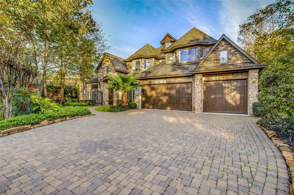Stone & brick custom home w/French flair is located in the coveted Provence enclave of CW Nicklaus. Cobblestone dvwy, front yard w/waterfall & sitting area, Wrought-Iron Gate, large double doors, 2-story entrance. Family Area w/ stacked stone fireplace & beamed ceiling.Expansive picture windows looking at a sparkling pool w/automatic cover. Every bedroom has an attached bath. Covered porch, outdoor TV, mini sports court & outdoor kitchen, Media rm, game rm & Wine closet. Chef's Kitchen & Breakfast area with huge granite island for prep or serve.Thermador appliances w/6 burner stove & double oven. Formal living room with limestone fireplace, large dining.Open & easy flowing floor plan. Pvt guest quarters w/ fireplace & pool view. Laundry rm w/double connection.Soaring ceilings, impeccable Millwork, gorgeous Hardwoods. Large master w/sitting area, bay windows w/pool view, tray ceiling, inlaid lighting. His & her closet plus secret closet. Library/Office, 3 car garage w/finished floors.