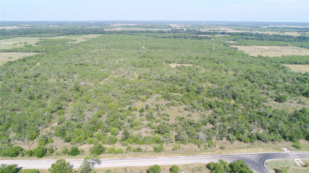 Heavily wooded ranch property located Southwest of Seguin with road frontage on Church Road and Sterling Road.  The vegetation on the property offers wildlife habitat and hunting opportunities and consists of mostly Mesquite trees and some Cedar Elm, Texas Persimmon a few Live Oak trees and native grass.  There is a working East Central water meter on the property and an electric meter that is currently disconnected.   From Church Road the land drains mostly to the East towards Elm Creek, a wet weather drainage creek.  A rare opportunity to own a property like this with lots of potential and several good building sites!