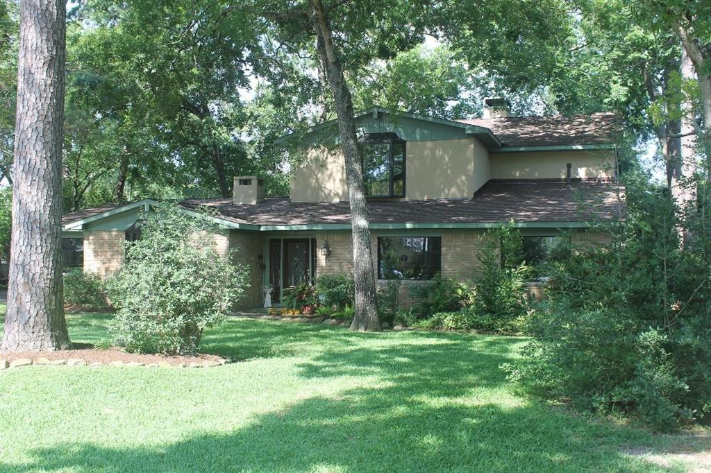 Sellers say it's time to downsize from their large Memorial area home of 33 years with large lot with 25 mature trees on a quiet cul de sac backed by a greenbelt- perfect for walks and a nice family ball game. A backyard pool and SEPARATE DETACHED GUEST QUARTERS (w/kitchen and bath) - a RARE find! The slate floors extend from the entry through the kitchen and breakfast room. Plenty of closets and storage.  Chef's delight kitchen with five burner gas cook top, double ovens, granite counter-tops, and breakfast bar. There are three wood burning fireplaces! Upstairs large master suite with balcony overlooking pool and greenbelt. The main house fridge and washer & dryer remain with the home. Guest quarters fridge also stays with the property. Located near City Centre, Energy Corridor, Terry Hershey Park, and Houston Audubon Edith Moore Nature Sanctuary.  Home Did Not Flood from Hurricane Harvey.