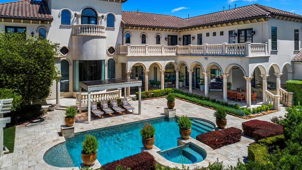 Never before available, this fabulous estate is being offered for sale for the first time since its original completion. Working with a renowned designer (Caroline Wheeler of Designer Dreams), the interior spaces received a total renovation – not one detail was overlooked in designing this stunning home. Impeccable materials were carefully selected from across the globe and masterfully installed by highly skilled craftsmen. The wrap around terraces and covered outdoor kitchen/dining space look upon the most breathtaking property. The privacy offered allows for total relaxation in the Zen gardens, by the Koi pond and while sitting by the pool. The home boasts 5 bedrooms, 6 full baths and 3 powder rooms – each uniquely designed. Each bedroom features a shower and stand-alone bath - the master bath will make your heart throb. The breathtaking living/dining/wine room is sprawling with the most magnificent walls of glass and provides a view of the pool/garden – you'll fall in love.