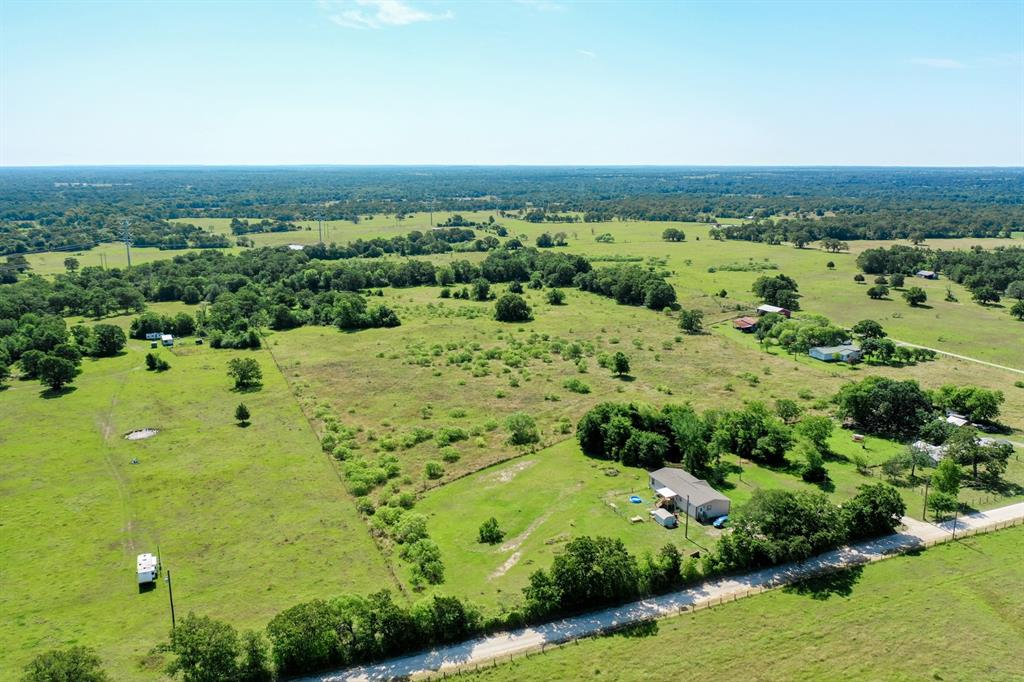 Beautiful, Secluded Acreage in West Madison County with quick access to Hwy 21 and approximately 30 minutes from Bryan/College Station.  This 28+/- acreage track is just right for hunting, fishing and agriculture being about 50% open/50% wooded.  Features include large established trees, fence, spring fed pond, an implement shed, and access to electricity.   Previously used for hunting and grazing agriculture, this property has some nice building sites and is unrestricted if you want to add a mobile home.  There is an agriculture exemption already in place and possible access to rural water.  Make this your new homesite or weekend retreat for making lasting memories family and friends.