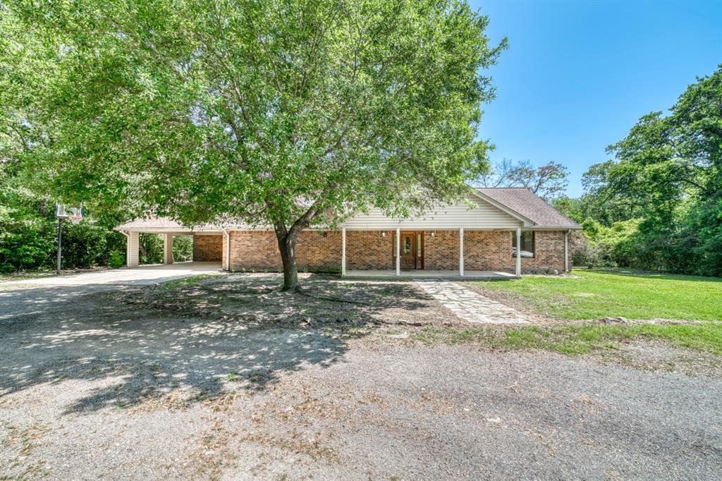 3 bed 3 bath home in the highly sought after Oak Forrest subdivision in the Madison County school district. Sitting on 1.5+- acres surrounded by huge oaks you would never know you had neighbors. There is an attached carport along with an outside closet for plenty of storage. There is a large living room with tall ceilings making the home have a neat open concept. The house has good bones and is a solid built home, however there are some updates needed. The home is being sold As Is.