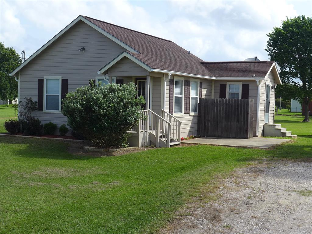 RELAX IN THIS CHARMING COTTAGE LOCATED BETWEEN WALLIS AND SEALY TX. HOME HAS LAMINATE FLOORS IN THE LIVING AREA CARPET IN THE BEDROOMS, AN INDOOR UTILITY ROOM, ENTRANCE FROM THE OUTSIDE INTO A 1/2 BATH. KITCHEN INCLUDES ALL THE APPLIANCES, STOVE, FRIDGE, DISHWASHER AND A BUILT IN MICROWAVE, BREAKFAST BAR & PLENTY OF CABINETS FOR STORAGE. CENTRAL AIR AND HEAT, TWO BEDROOMS AND A TILED FULL BATH, WASHER AND DRYER ARE INCLUDED WITH THE SALE. OWNER HAS ADDED AN ADDITIONAL STORAGE AREA 1/2 OF IT IS FINISHED WITH ELECTRIC PLUGS AND A WINDOW UNIT, THIS COULD BE A NICE OFFICE OR GUEST BEDROOM. THE OTHER 1/2 HAS A ROLL UP DOOR AND HAS PLENTY OF SPACE FOR THE LAWNMOWER AND TOOLS. THERE IS A SECOND METAL BUILDING FOR ADDITIONAL STORAGE. COVERED CARPORT TO PROTECT THE AUTOS AND THE HUGE YARD IS FENCED AND READY TO BE OCCUPIED. BRING THE PETS AND ENJOY THE COUNTRY LIVING.