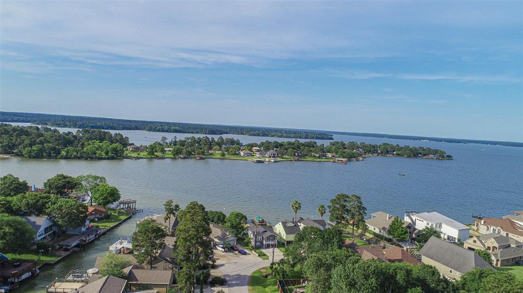FEEL LIKE YOU ARE ON VACATION EVERY DAY! This Lake Conroe WATERFRONT home for under 280k is a rare find! Enjoy all Lake Conroe has to offer for a great price. There is a jet ski lift and plenty of water in this short canal to wide open Lake Conroe fun. You have great outdoor spaces with the covered patio off the back door, and another covered back deck area closer to the water. Jump on your jet ski and be on the open water in minutes. You could add a boat slip if you choose, or tie up to the bulkhead. There is a community boat launch just around the corner to make launching your boat quick and convenient. Inside is very nice as well. Beautiful views in a wide open living, eating, and dining floor plan. Great for full time living or a weekend getaway. Spacious bedrooms, indoor utility room, and a nice garage/workshop area as well. Clear Water Cove is in MISD, and a nice community with low HOA fees and LOW tax rates. This is a great opportunity for a great price. Come get it!