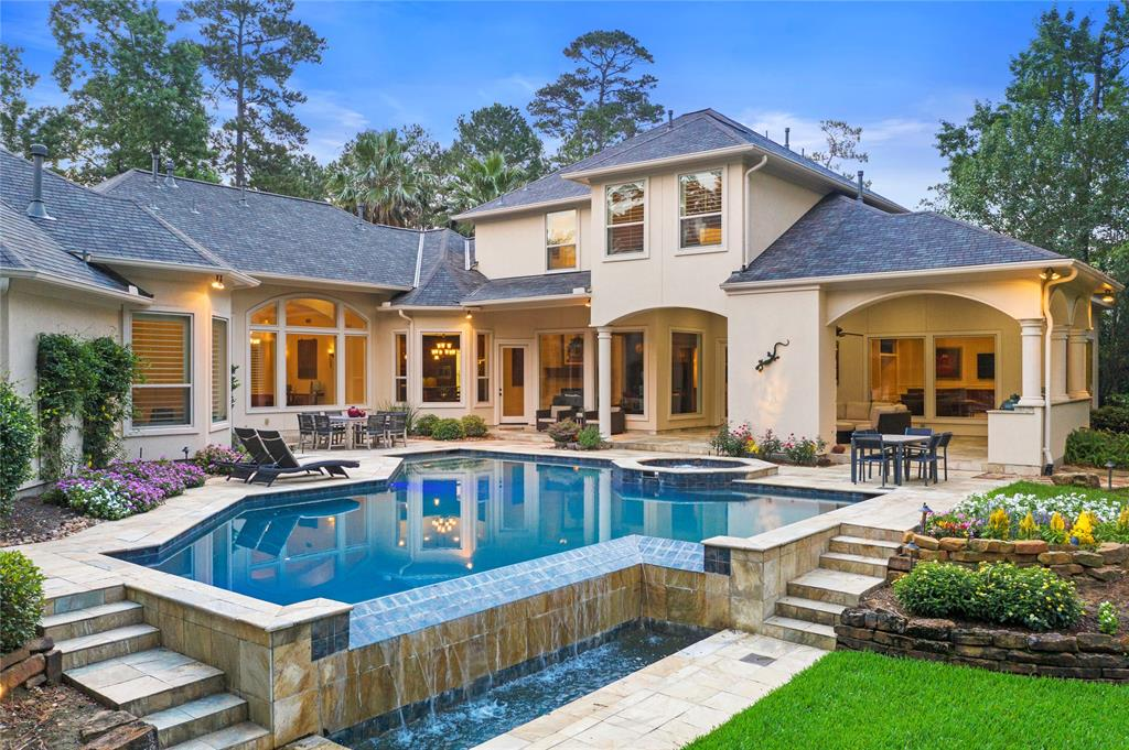 Nestled in a secluded neighborhood in The Woodlands, 239 Starlight Pl is a magnificent estate proudly situated on a 1.47-acre cul-de-sac lot. With 6,301sqft of living space and 5 bedrooms, 6 full and 2 half baths, this home guarantees privacy for everyone. The expansive and open floorplan provides an ideal indoor-outdoor setting for entertaining guests in social gatherings and the wall of windows allows for stunning views of the backyard. Indulge in the heated, saltwater pool with hot tub/spa and enjoy the extraordinary covered patio with recently upgraded outdoor kitchen and a fireplace. The primary suite, on the 1st floor, is truly a luxurious retreat with inverted ceilings, fireplace and a primary bathroom boasting a jetted tub, separate shower, double sinks and walk-in closets. A spacious game room is perfect for quality time with family and friends! Other highlights include media room, indoor gym, study/library, 4-car attached garage, tile flooring and elegant crown molding.