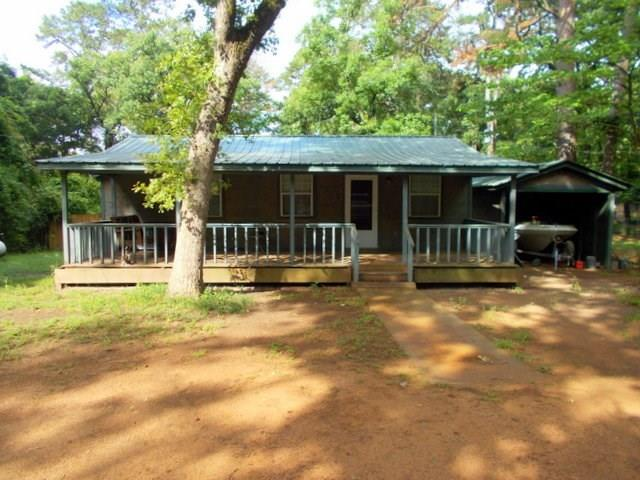 Nice property for a weekend retreat located at beautiful Houston County Lake. This cottage offers over 900 square feet of heating and cooling. It is situated at the end of a road in the Tejas Shores Subdivision. There are two bedrooms 1 bath along with an open concept floor plan for the living area. The property has been completely updated in the last two years. Some of the updates are; metal roof, flooring, paint, addition of a bedroom, wiring, plumbing, and a new covered front porch plus a great back deck off the back enclosed in a privacy fence. There is also an extra lot that is included in the sale with access to the subdivision boat ramp and swimming pier. Call us to see all this property offers!