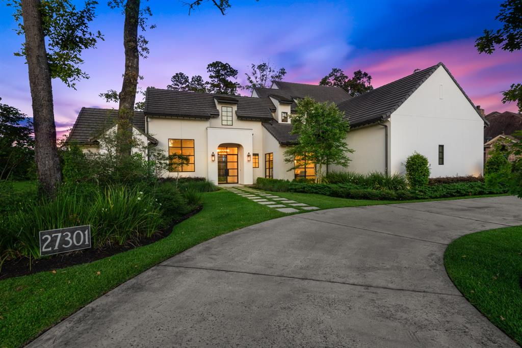 Luxury custom waterfront estate on 1 acre! Stunning entry with direct view of pool and lake! Walls of oversized commercial windows providing amazing views of property and an abundance of natural light! Built in 2016, home is completely move-in ready with upgraded designer finishes! Chef's kitchen with massive island, marble counters, farmhouse sink, & commercial grade range with 6 burner cooktop, griddle, & double ovens; Family room with French doors to back patio and gas fireplace with Cantera tile surround; Master bedroom with shiplap ceiling and sliding barn door entry to master bath retreat featuring walk-in shower, freestanding tub, & wood paneled ceiling; 2nd bedroom down with en-suite bath; 3 bedrooms/3 bathrooms, gameroom, and bonus room upstairs. Outdoor oasis with expansive covered patio, outdoor kitchen, fireplace, pool/spa, and waterfront views! Circular driveway, spray foam insulation, water softener, tankless water heaters, & so much more!
