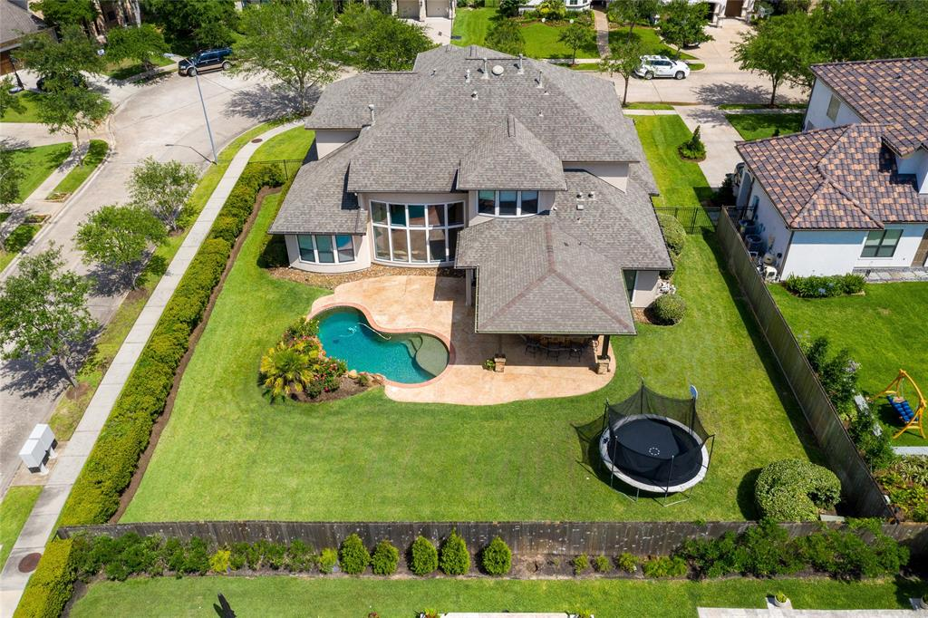 This gorgeous 5 Bed - 4.1 Bath, Partners In Building Home, is located in the highly sought after section of The Legends of Waters Lake.  With only 26 homes in the section, it allows for oversized lots, wide streets, and lots of space to run & play.  With a stunning stucco elevation, this home has high ceilings throughout, 8ft doors, custom light fixtures, newly renovated kitchen, and floor to ceiling windows.  New interior paint and carpet, this home shows beautifully.  Master and secondary located downstairs.  Perfect for a guest room or even a second study. Outdoor living space features covered patio, custom stone bar perfect for entertaining, pool, and lots of green space.  Perfect location from schools, multi-million dollar sports complex, area pools, golf course, amphitheater, and miles of walking trails.