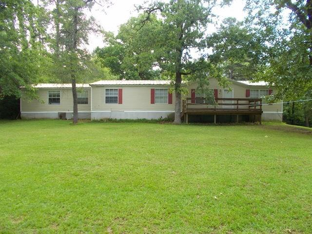 This property has room for everyone! This manufactured home is in Golden Acres Subdivision offering over 2,300 square feet of heating and cooling. The property features a large kitchen with lots of cabinet and storage space and eat at island along with a great walk-in pantry. you will find 2 large living areas with a fireplace in one of them and the other has wood walls and ceilings perfect for a game room or a man cave. The large master bedroom features two walk-in closets along with a spacious en-suite bathroom that offers a wall- in shower and a garden tub. Outside you will notice the new metal roof, wooden deck, storage building. This property has 1.399 +/- perfect for relaxing and enjoying the outdoors. Call us to see this property today!