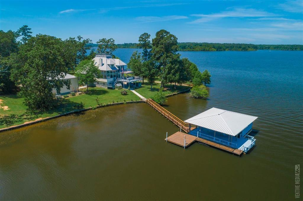 "Breathtaking Panoramic Views is what you'll find in this Unique and One of A Kind Home on Toledo Bend! This property features a three plus story home, 50x40 climate controlled, commercial grade shop, small greenhouse, private boat launch, boat house and fishing pier with locking storage room, and swim dock. This 'unicorn' features four bedrooms, three and half baths, and a wall of windows in the family room, kitchen and dining areas with waterfront views in nearly every room of the house! Enjoy sunning on any deck or relaxing in the shade, this home literally does have it all! Three stories have you worried; you will love the new Oracle Elevator! The ground level offers a three car garage, office, tv/exercise room, storage room and you can ride the elevator from hereto the two living levels. To reach the ""WIDOWS WATCH"" you will climb a spiral brass staircase to the 4th level and unseen views of Toledo Bend Reservoir. New landing strip coming soon to make your commute a dream!"