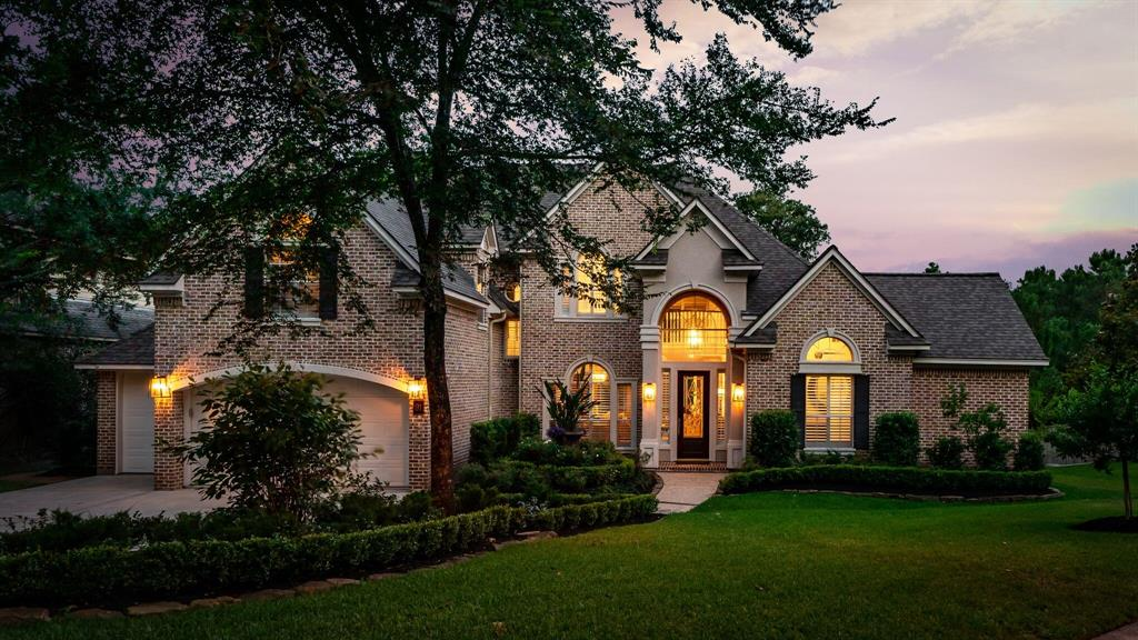 Exquisitely updated custom home by Tommy Bailey on what could be the most beautiful lot in The Woodlands.  Located on a lush landscaped lot at the end of a cul-de-sac, the home sits up on a hill overlooking the George Mitchell Preserve & pond. You will forget you're in The Woodlands while sitting on the large covered porch overlooking the tops of trees as far as the eye can see!  The outdoor kitchen, mosquito misting system, outdoor lighting and serene salt water pool & fire pit make this a home for entertaining or just enjoying the outdoors.