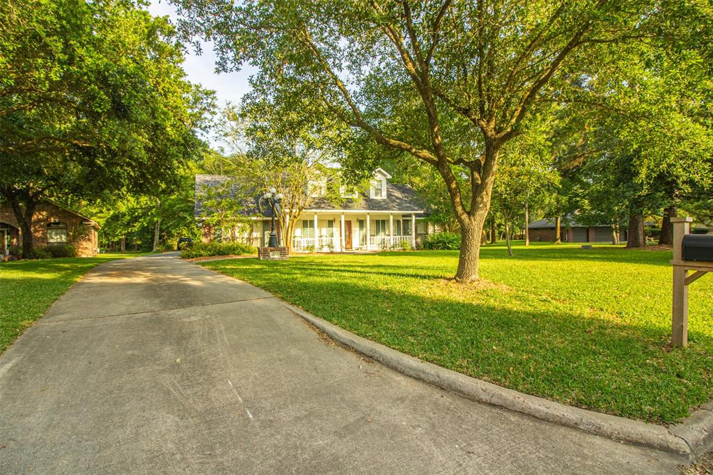 WOW! Rare find with almost 2 ACRES in Point Aquarius on Lake Conroe! LOTS OF SPACE for kids to play or use as you wish. Trails are cut through the woods to explore and find the 'secret' fort, and plenty of land for a garden and toys. This home also has a 42' x 28' garage/workshop with a 12' door and 2 8' doors for 3 total bays and lots of extra parking! This is a great space to make your own and enjoy. The outdoor paradise continues with a covered porch and patio to enjoy nice evenings. This home also has LOTS OF UPDATES including NEW roof, NEW paint, NEW flooring, NEW granite counters, NEW fixtures, and more! It shows great with hard wood floors throughout much of the first floor and master is downstairs. Upstairs is a massive game room with 2 more bedrooms and 1.1 bathrooms. You get all this while still being in a Lake Conroe community with a marina and slips available for rent, a boat launch to be on the lake quickly, pools, tennis, basketball, and more. HAVE IT ALL with this one!