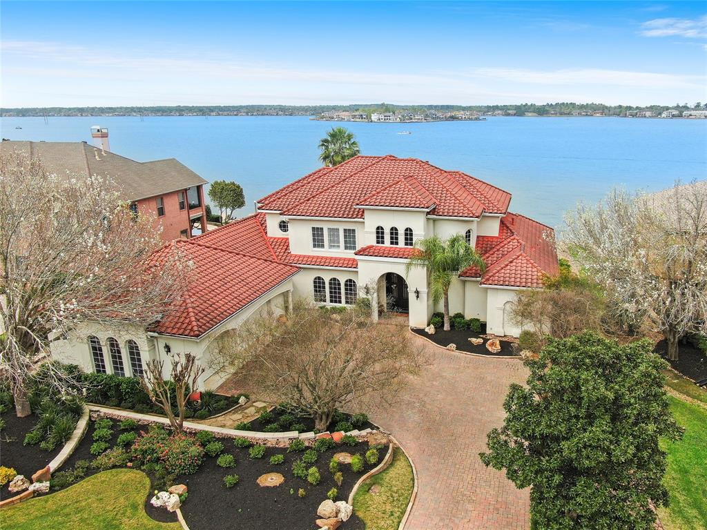 Gorgeous Corky Shaw custom built home nestled on the shores of Lake Conroe in The Estates of Walden. If you are looking for the best wide open views on Lake Conroe then your search stops here! These views are framed out in an amazing structure that offers 4/5 Bedrooms with 5 1/2 baths, sauna, amazing resort size pool trimmed out in travertine and hot tub to boot!  Spacious master suite down stairs along with another flex room that could be 2nd bedroom down or a game room or whatever your heart desires. Butt glass extends across the back of this beautiful home and provides expansive lake views! Tons of space in the garage for all of your cars and/or watercraft trailers etc. You will find three extra bedrooms upstairs along with 3 full baths plus a game room/secondary living space with large balcony to take in all of those breathtaking lake views! Don't miss seeing this one today!