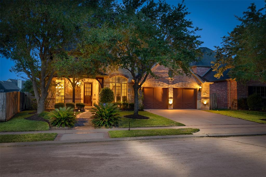 Beautiful Two-Story Home Built by Highlands Homes Located in Telfair Zoned to Top Fort Bend ISD Schools. Contemporary Open Floor Plan w/ Tile & Wooden Flooring Throughout the Home. Spacious Secondary Living Room w/ Plantation Shutters & High Ceilings. Formal Dining Room with Elegant Chandelier & Easy Access to Stunning Kitchen with All Stainless-Steel Appliances Including Samsung Family Hub Smart Fridge! Beautiful Granite Countertops, Double-Oven & Oversized Island. Gorgeous Family Room w/ Tons of Natural Light & Exquisite Stone Gas Fireplace! Marvelous Master Bedroom with Wooden Floors & Crowned Ceilings includes Luxurious Master Bath w/ Jacuzzi Tub, Double Vanity, & Large Walk-in Closet! Amazing Floor Plan w/ 4 Bedrooms including Game Room, Media Room, & Two-Car Garage w/ Built-in Shelving for Extra Storage. Large Spacious Backyard w/ Amazing Park Set Included & Lovely Landscaping. Fantastic Location near Hwy 6 & Southwest Fwy! MUST SEE THIS BEAUTY!