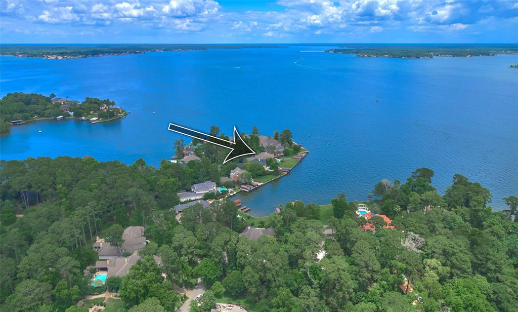 Stunning TRUE open waterfront custom home in the exclusive gated community of Waters Edge located on the Walden Peninsula! The rear of this home faces northeast providing incredible sunrises and panoramic views of Lake Conroe including the light house. The outdoor oasis features 2 new boat docks with hydrolick lifts, 2 jet ski lifts, fishing lights, an in ground trampoline, pool w/ spa & slide, pergola, and outdoor kitchen.  Bring your family and friends to enjoy the lake life!  This property has plenty of space with 5+ bedrooms, 4 full bathrooms, study, dining room, 2 family rooms, gameroom, craft room, sunroom, oversized 3 car garage, endless storage, a huge backyard for entertaining, generator, and a circular drive for extra parking!  No flooding and no problem getting your boats/jet skis out during a drought!  Montgomery ISD and a low tax rate!