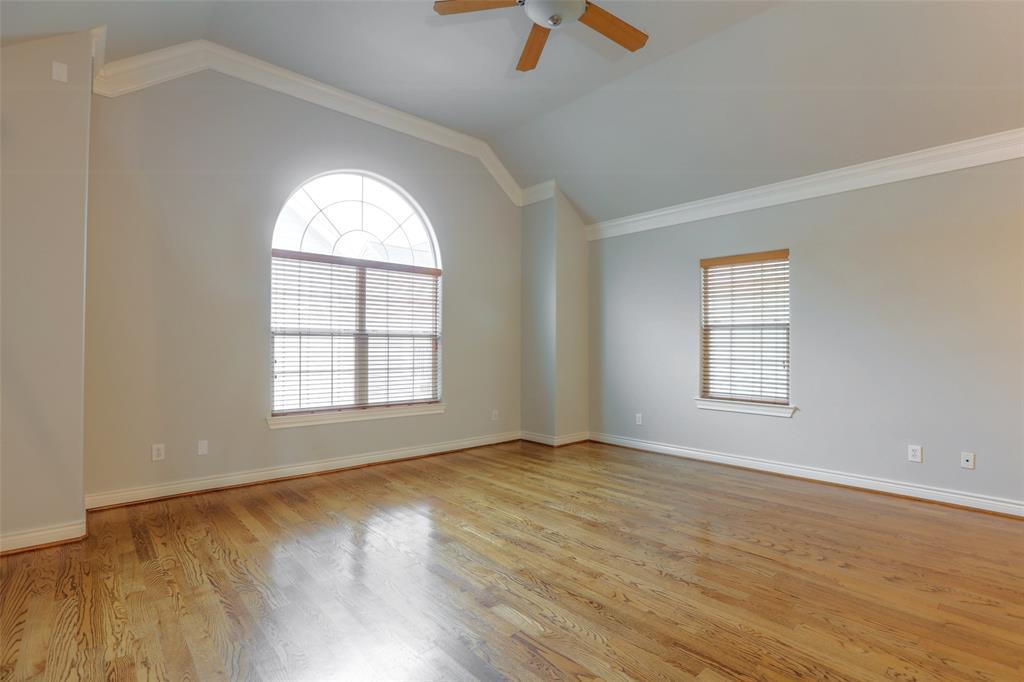 Spacious second-floor living area with beautiful hardwood floors.