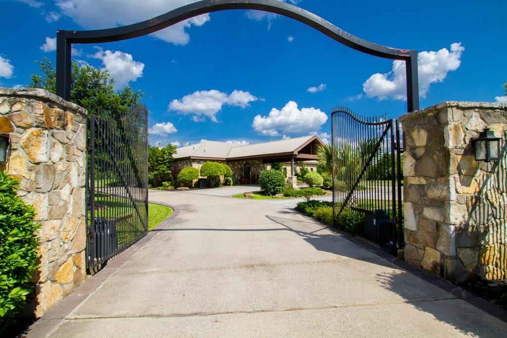 AN ENTERTAINERS DREAM AWAITS….One story, Acreage, Pool, Stables, Room to Breathe with City Conveniences! This incredible ranch style home is designed with open floor plan for entertaining but plenty of privacy w/master on one end & secondary bedrooms on the opposite. The custom estate features rich custom cabinetry, granite counters, custom stone work, vaulted ceilings, 8 ft doors & breathtaking views from almost every room. No detail was overlooked in the massive patio area w/covered space for dining, second story party balcony, lagoon pool w/multiple stone waterfalls & 10 person spa.  But wait…the acreage includes a 6234 sq. ft barn/workshop (3600 enclosed/2634 covered pavilion) which has 4 feed/tack/utility rooms, office/kitchen & 4 indoor/outdoor stalls. The 43'x56' covered pavillion overlooks the pond & fountain: a hospitality haven. Fantastic access to Grand Parkway, the quaint town of Tomball & the city conveniences of The Woodlands.  Please see the Full Feature Sheet.