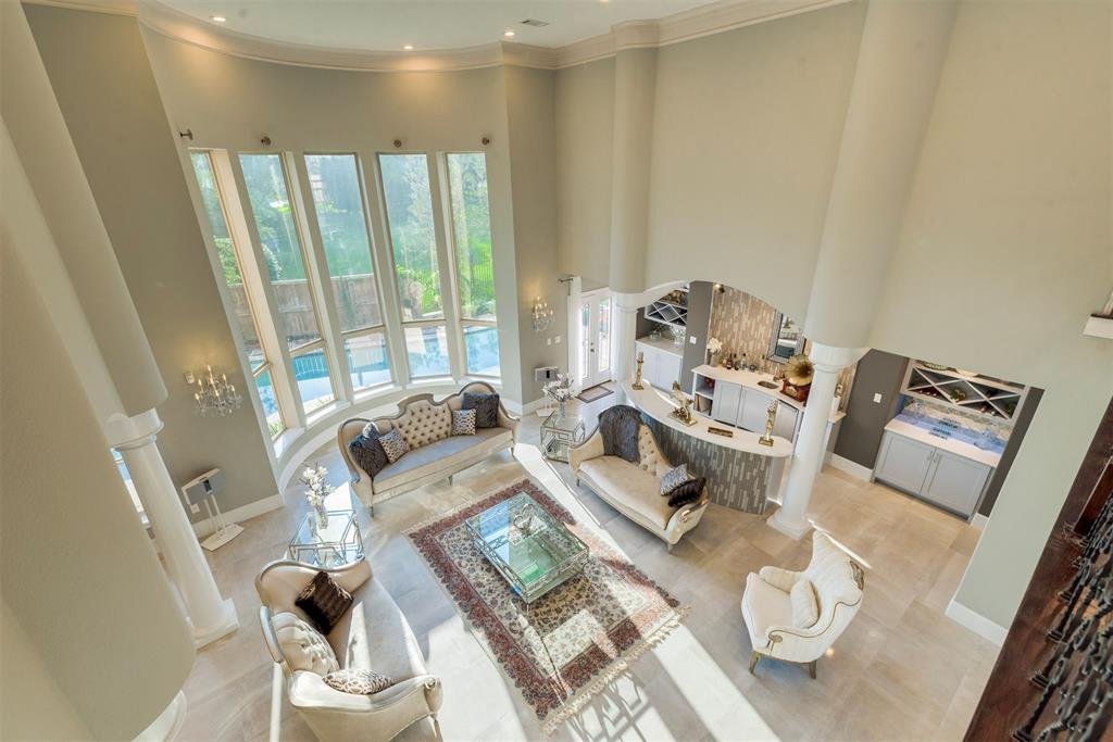 Another fabulous REMODELED HOME in the highly sought after guarded community of Memorial Thicket. This home was a gorgeous custom home before, and now it is even better! OVERSIZED LOT with green space and a SWIMMING POOL for enjoying Houston summers, this home is also on a cul-de-sac with no through traffic. Step through the double door entry to a breathtaking entry with SOARING TWO STORY CEILINGS accented by a sweeping double staircase and exquisite crystal chandeliers. The MODERN INTERIOR has all high end, elegant finishes including MARBLE FLOORS throughout the downstairs. The kitchen features COMMERCIAL GRADE STAINLESS STEEL APPLIANCES and is open to an informal den for today's modern lifestyle, while a more elegant formal living and dining room combined create the perfect ENTERTAINING SPACE. Seller added a NEW POOL with TRAVERTINE coping to enhance this oversized back yard. Downstairs Master suite with sitting area, fireplace & spa-like, luxury bath.  Zoned to Bush Elementary.