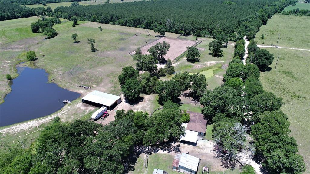 If you are looking for the perfect place to ride and train horses, this is the place for you! With 18 acres of land the opportunities are endless! This property is outfitted with a 227'x150' roping and cutting arena complete with steer chutes, water, and electricity. The property also includes a 16'x14' tack room and 17 – 10'x10' horse stalls, 9 of which are covered. This property is complete with its own water well, two ponds – one stocked with bass, catfish, and perch. Inside the 3-bedroom, two-bathroom home, you will find an open floor plan throughout the kitchen and living area. The living area is cozy with a wood-burning stove. The island kitchen has lots of counter-space and tons of cabinets. There is a handy laundry and the dining area is perfect for dinner guests or could be turned into a 4th bedroom. The master bedroom is spacious and has a private bath with his and her sinks, walk-in closets, jacuzzi tub, and separate shower. Two guest bedrooms share a hall bath.  Call today!