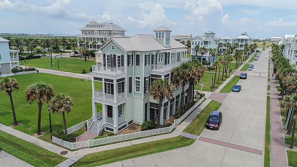 True elegance nestled on a corner lot in prestigious Beachtown offers Gulf views from each room! Bright, subtle coastal colors throughout. Open floor plan with a wall of windows/doors/transoms. Island kitchen with stainless steel appliances. Travertine flooring down, seagrass up. Each bath showcases designer tiles, hardware & fixtures. 2nd floor Master AND 2nd living area. Double South-facing decks with multiple accesses allow you to step outdoors and enjoy the Southerly breezes all year long. Elevator travels to all levels.  2 Car garage large enough for extra storage.  Azek decking all around.  Some furniture remains.