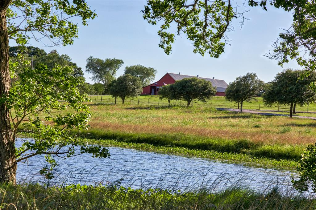 Wonderful commercial investment or family country estate on 40 acres of rolling hills only minutes from downtown Brenham. Enter the tree lined drive past the picturesque pond with pier and gazebo to a beautiful 80+ year old red barn which has been converted into a venue space for weddings, events, or family reunions. The Main hall is framed in reclaimed barn wood, stained concrete floor and stage for bands, speakers, or wedding ceremonies. 2nd Hall, kitchen, separate Bride and Groom rooms each with full shower/bath. Steps away is the perfect home for entertaining with 5 bedrooms, 3 full & 1 half baths. Living area with cathedral ceilings and stone fireplace. Updated chef's kitchen with breakfast area, island, and bar. Gorgeous resort like outdoor space with built in kitchen, dining, pool, water fall and slide, outdoor separate shower/bath and fire pit sitting area ideal for star gazing. Halfway between Houston and Austin and only 45 minutes from College Station. Agriculture exemption.