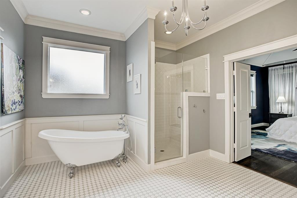 A full shot of the soaking tub and shower stall with bench.