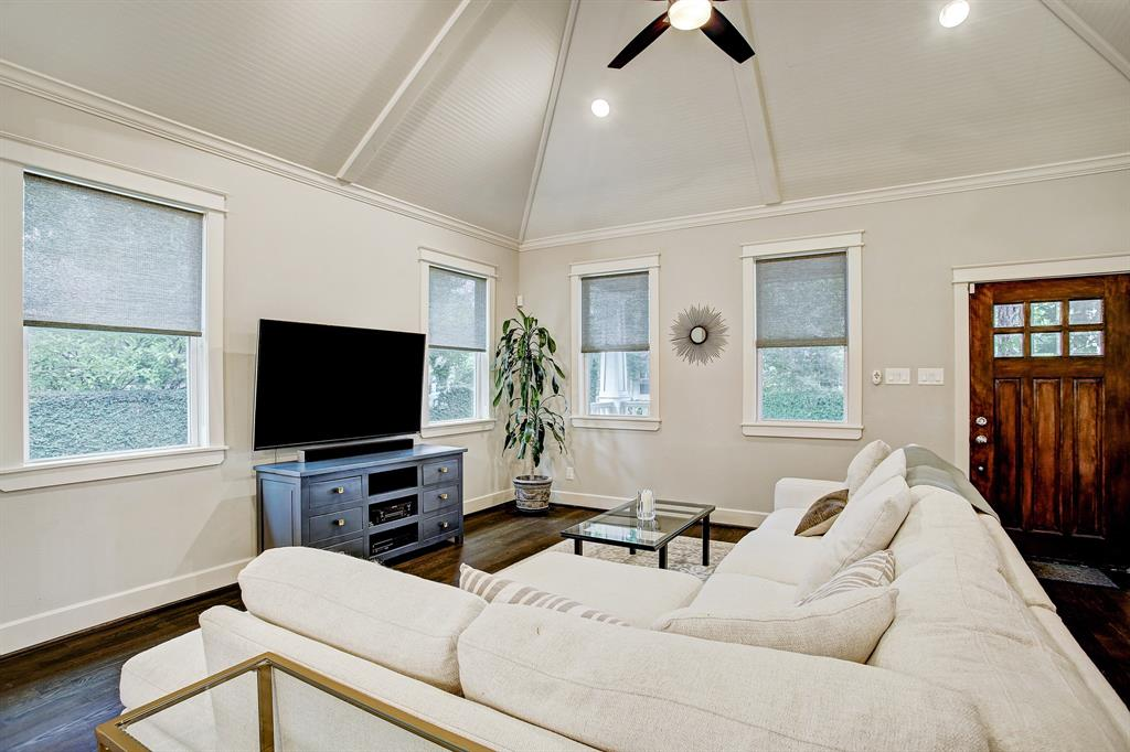 Enter this home into a living room which readily accommodates big, comfortable furniture, and has a soaring architectural ceiling.  There is abundant natural light and custom window treatments throughout.