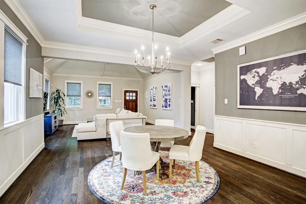 This angle best shows all the wonderful wall space, and tray ceiling in the dining area.  The hall to the right leads to a full bath with a bedroom on either side.