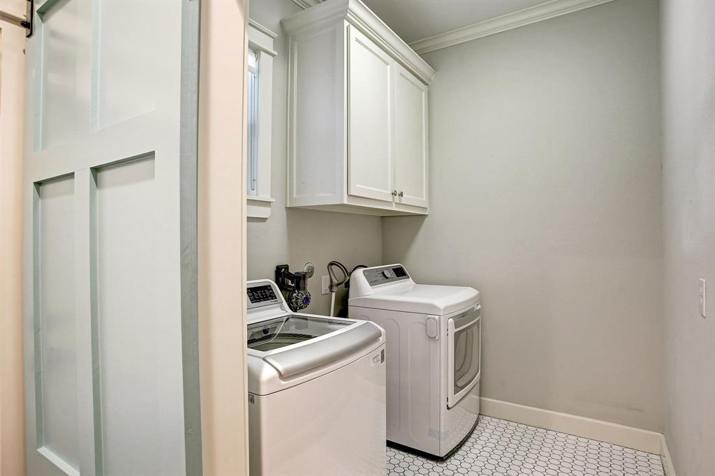 Another unusual feature of this home is an actual laundry room, in the house, with cabinets and storage space.  The sliding