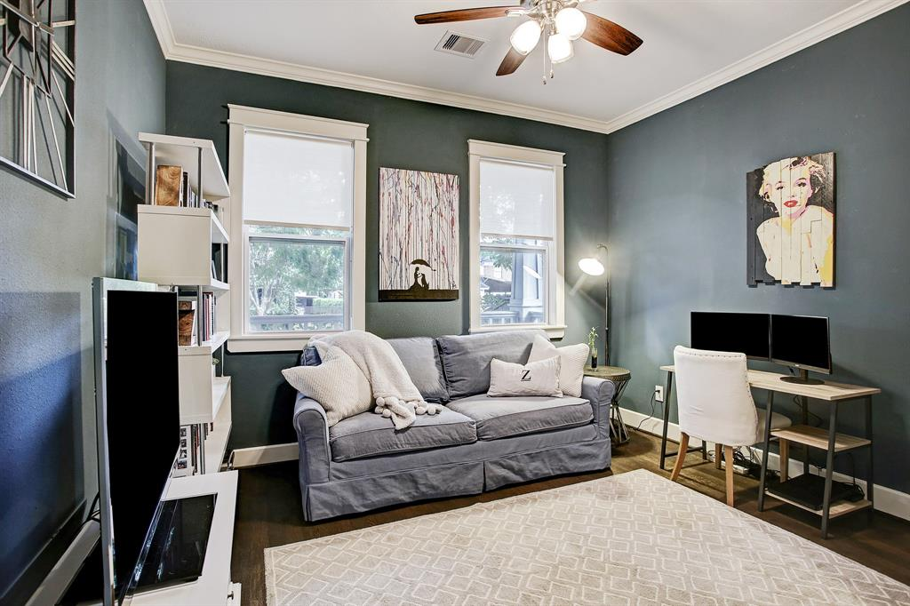 This secondary bedroom sits at the front of the home overlooking the front porch.