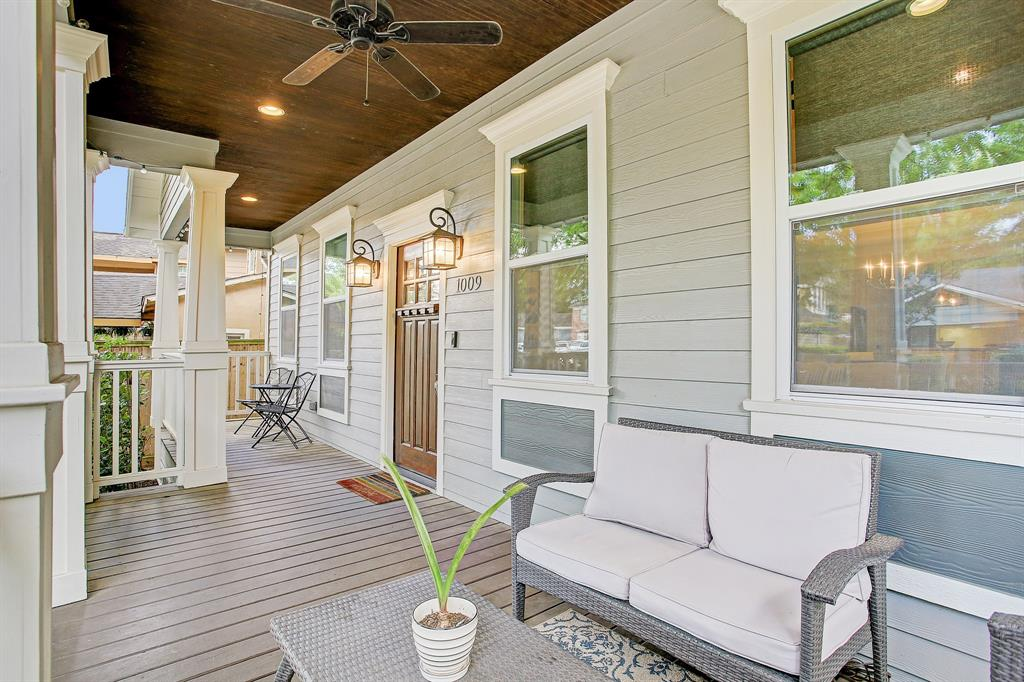 There is room on the porch running the length of the front of the home, for two separate sitting areas.  The far windows are to the first of two secondary bedrooms, and the near windows are to the living area.
