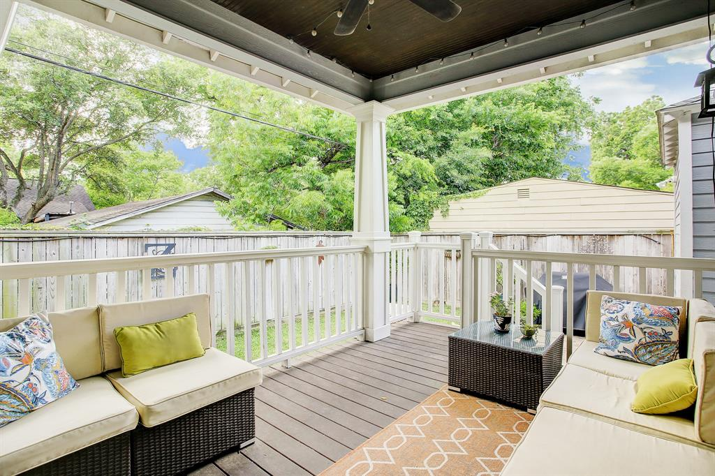 At the back of the property enjoy private outside space under this covered deck/porch with a ceiling fan, accessible from the primary bedroom and hall.